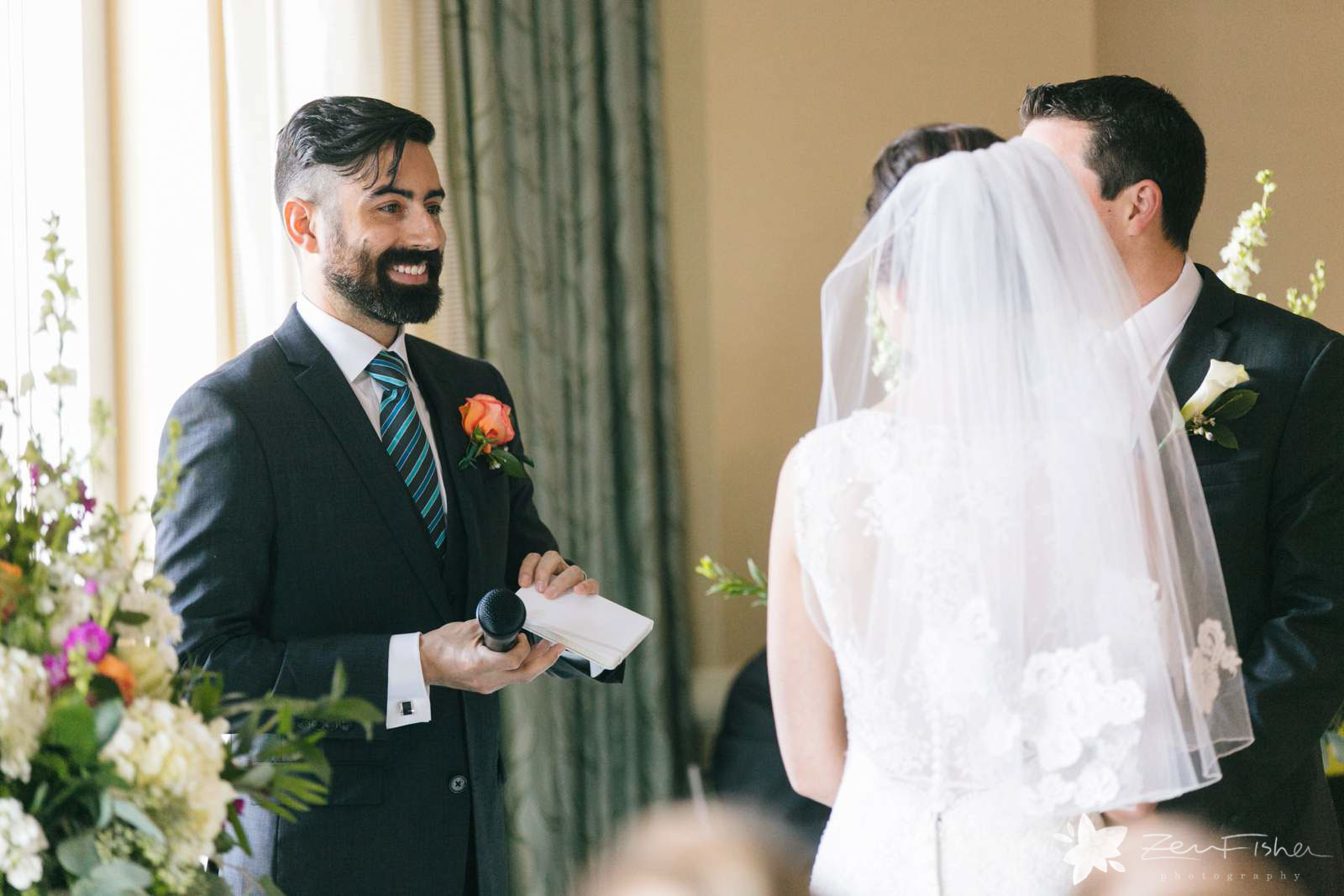 Best man makes a blessing during wedding ceremony. Brother of bride smiles at bride