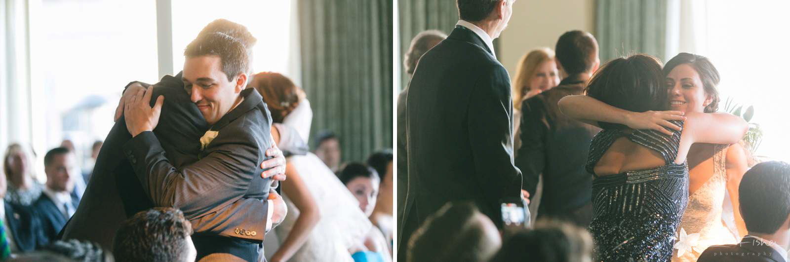 Bride and groom hug their parents during the wedding ceremony.