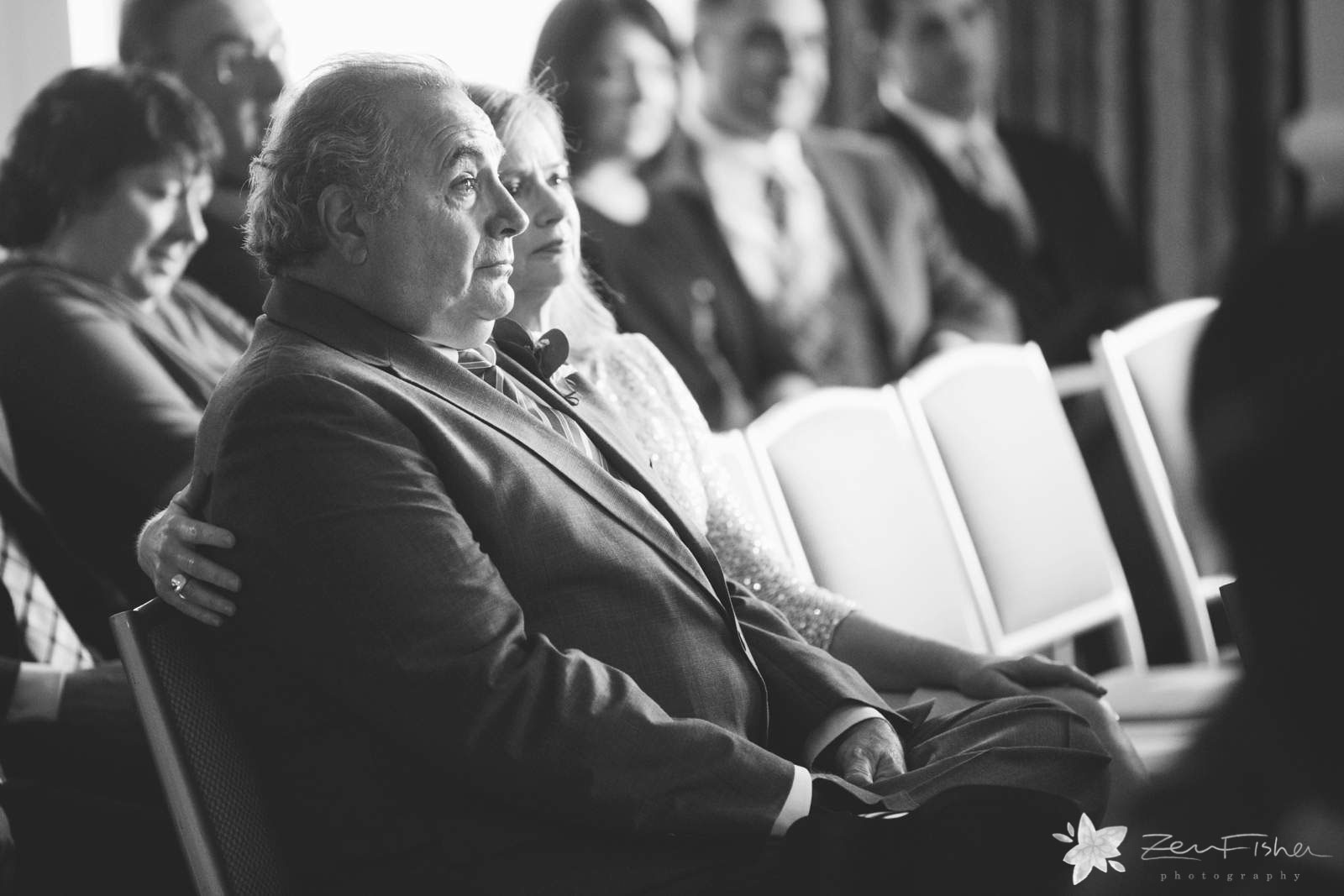 Father of the bride's reaction during ceremony, father of the bride tearing up, black and white.