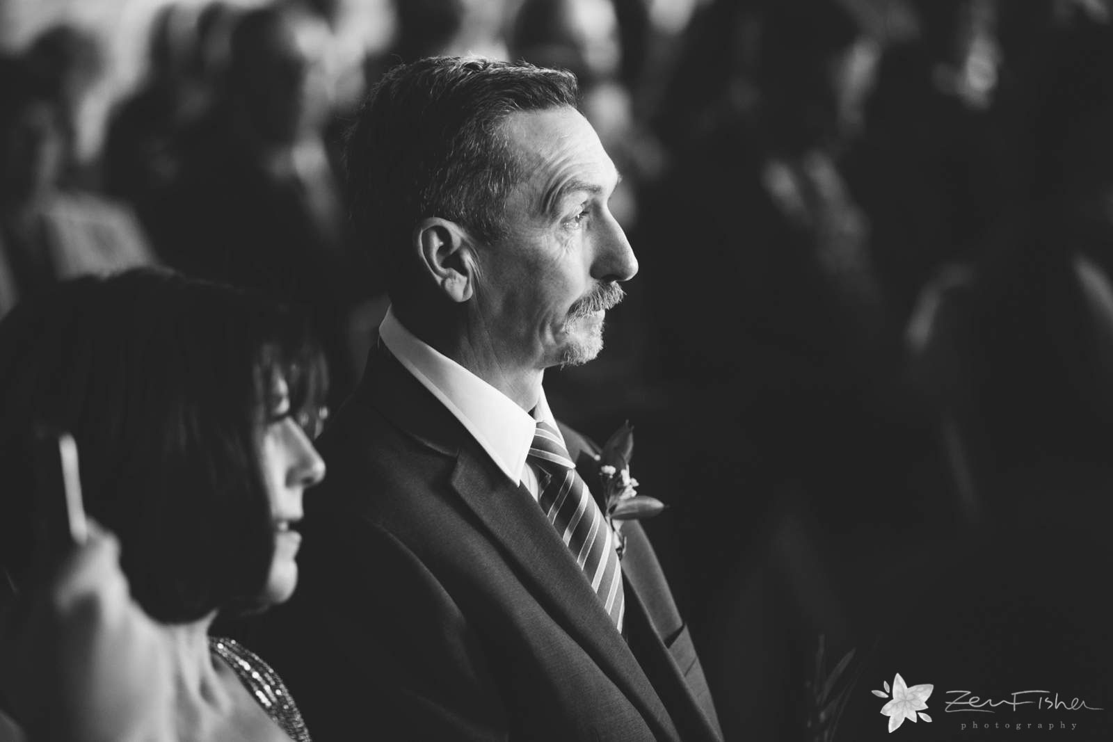 Father of the groom's reaction during ceremony, father of the groom tearing up, black and white.