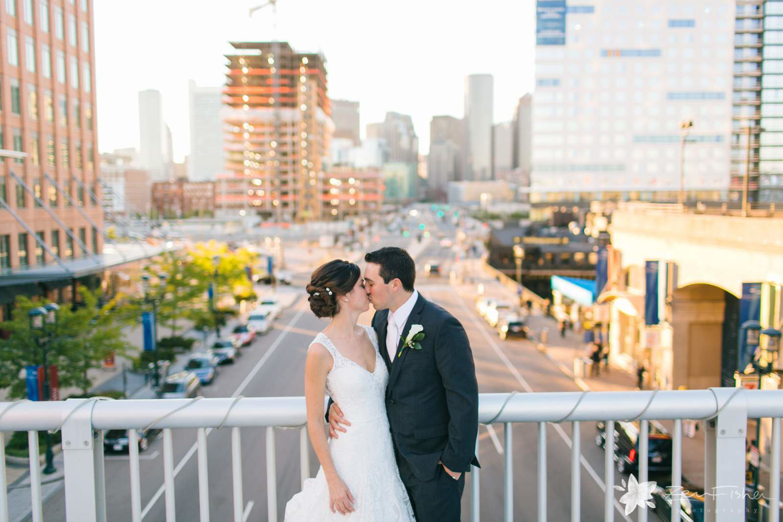 Bride and groom portrait kissing on bridge in fort point outside Boston Harbor Hotel