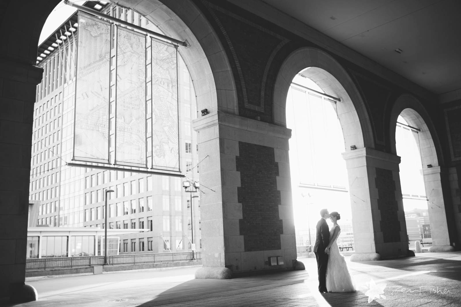 Black and white romantic bride and groom portrait with architectural elements and ethereal light.