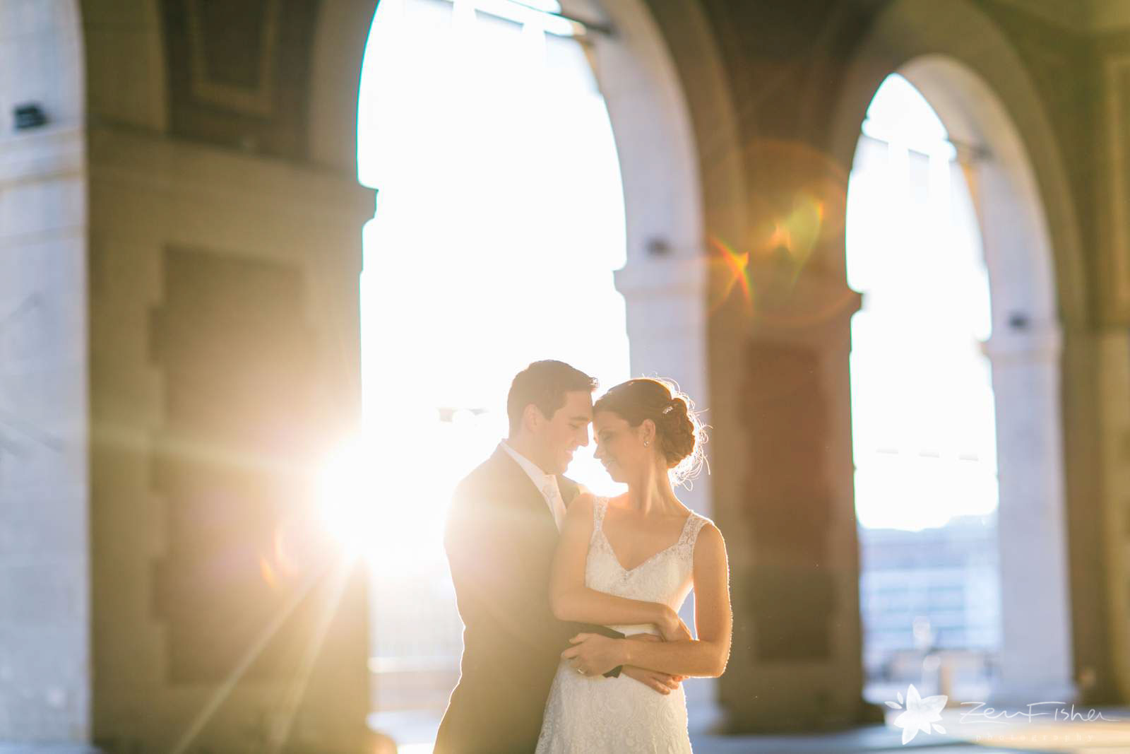 romantic sunset bride and groom portraits with architectural elements and ethereal light.