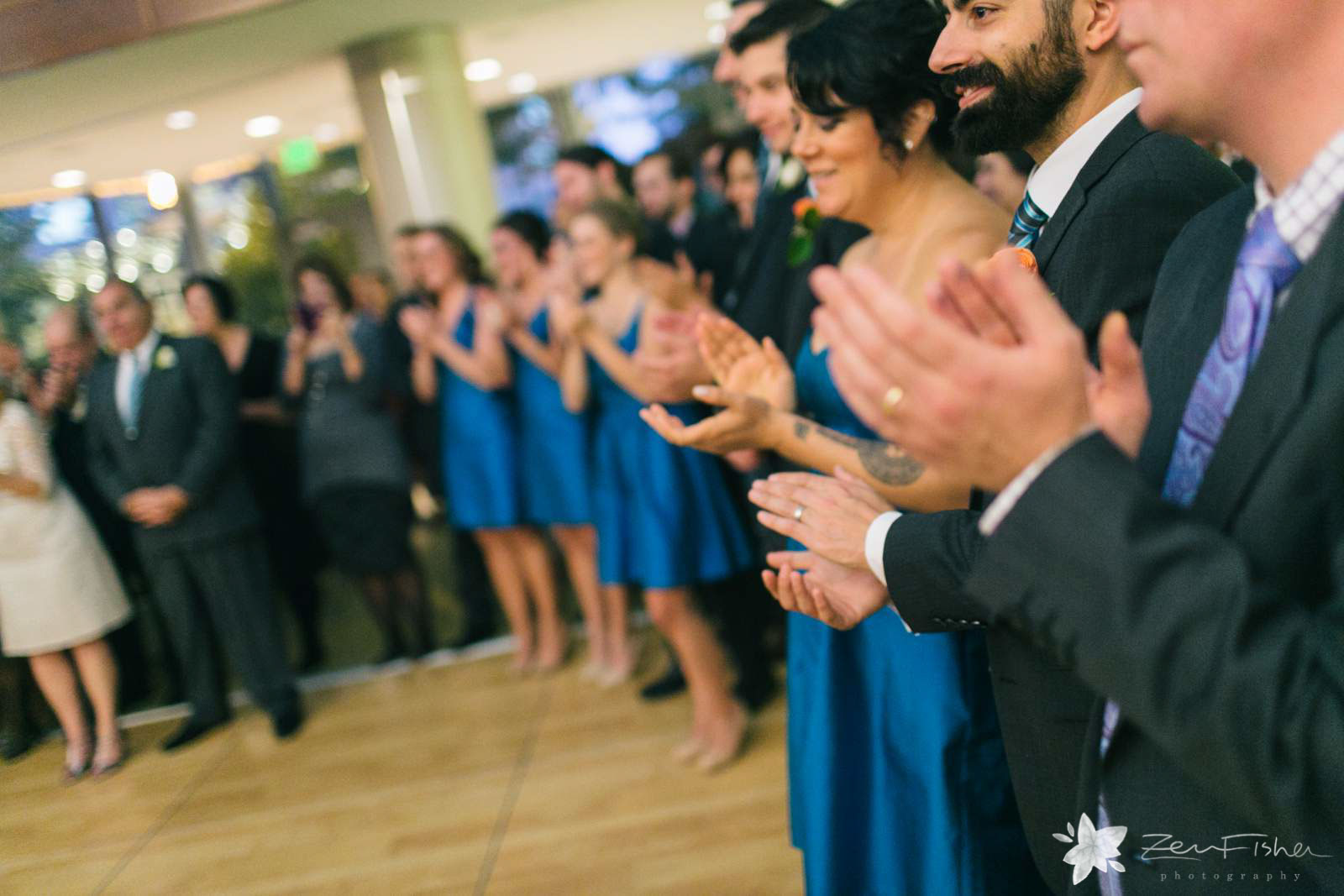 Close up of guests clapping during first dance.