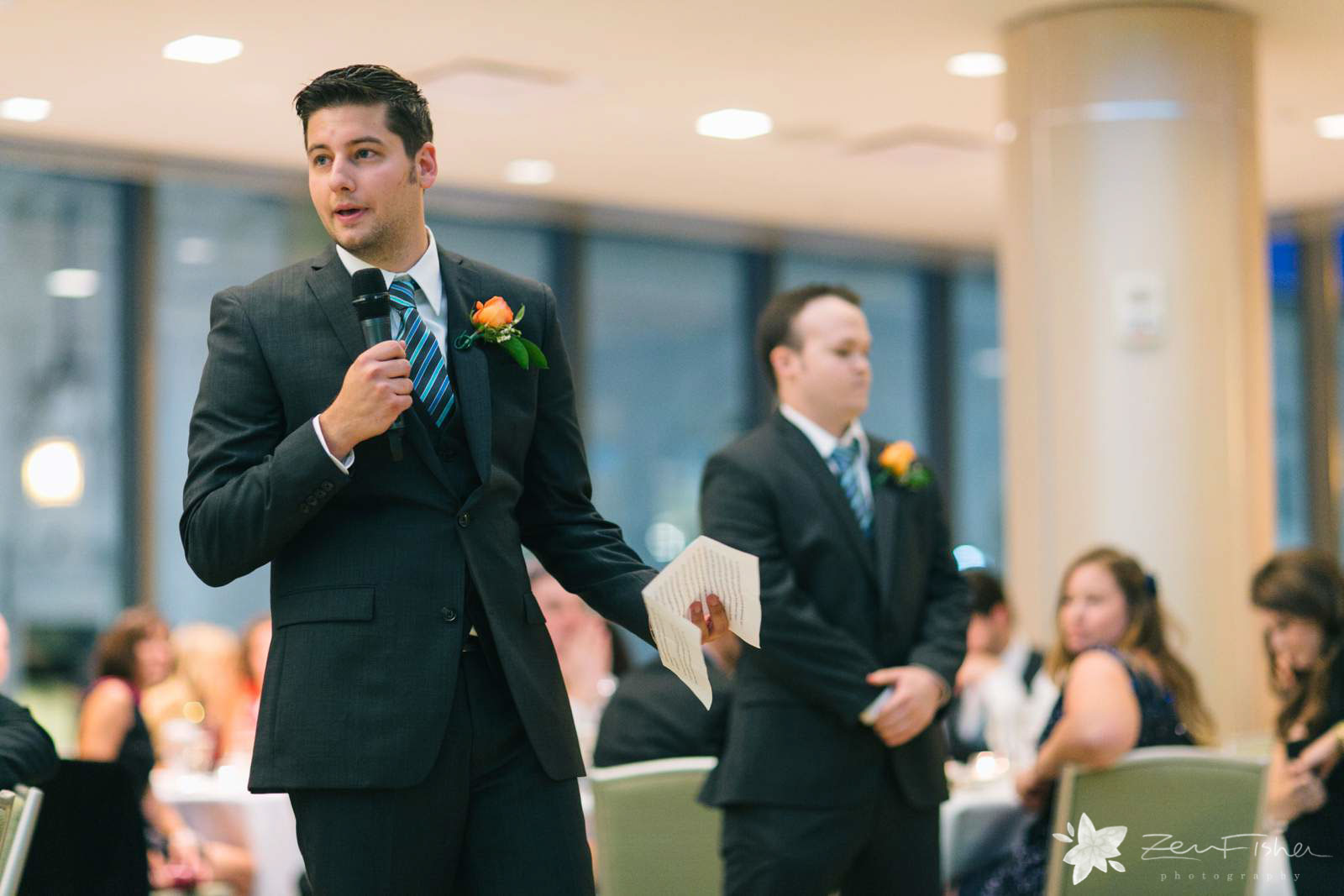 Groomsmen making a toast during wedding reception at Seaport Hotel Boston.
