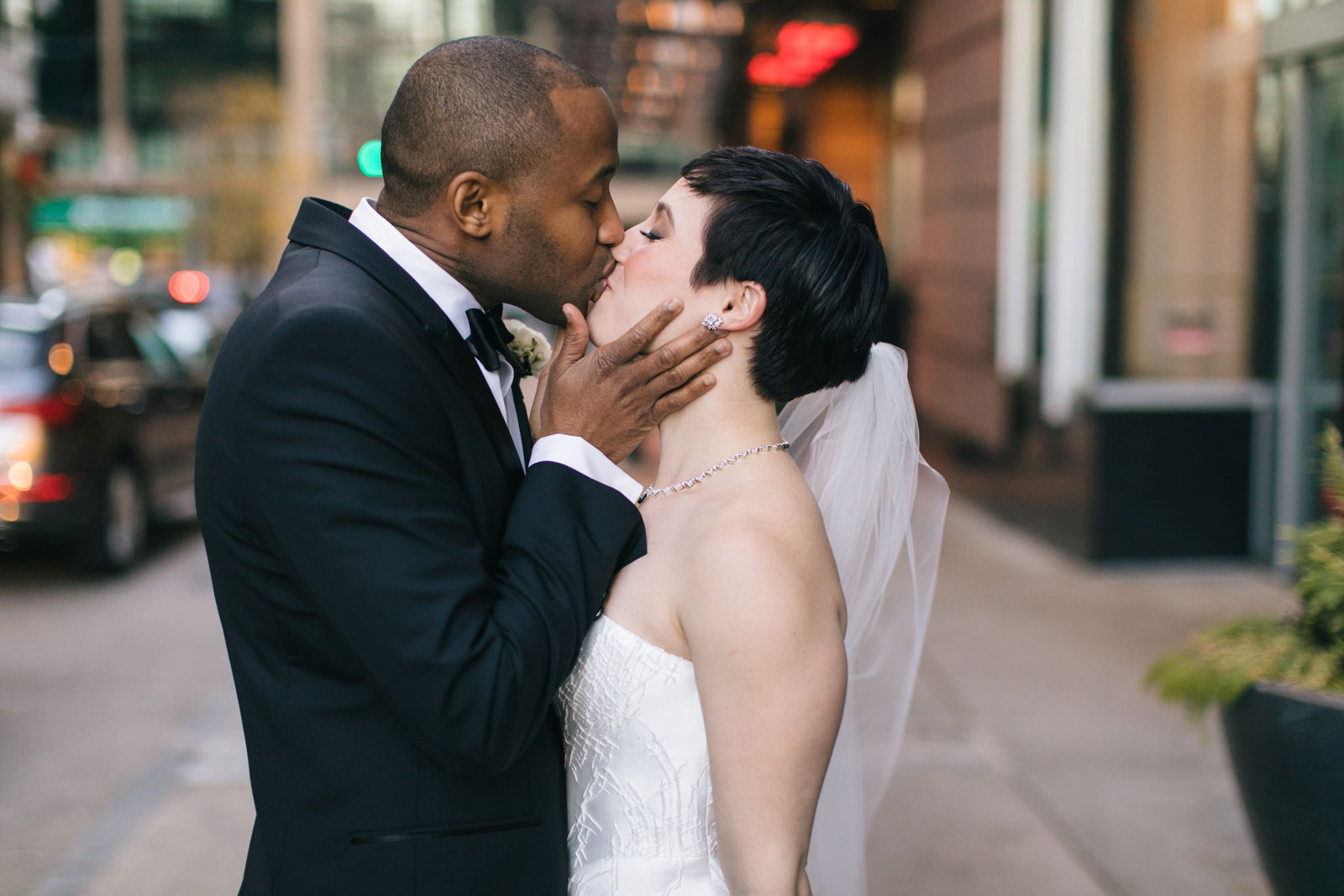 intimate portrait of bride and groom kissing on the streets of Boston in winter