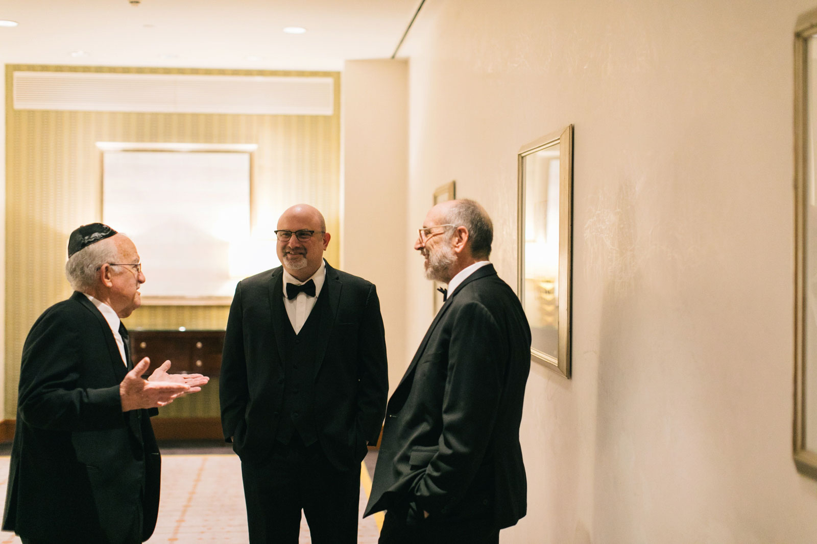candid of wedding guests mingling before wedding ceremony at Ritz-Carlton Boston