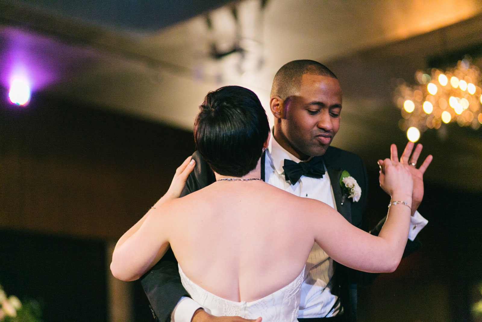 Groom busting a move during his first dance at interracial wedding Boston
