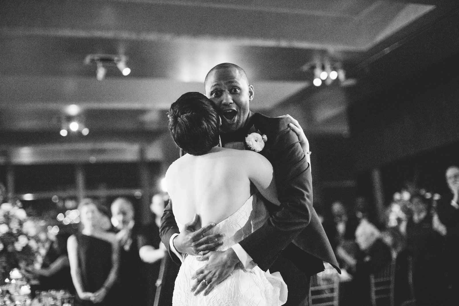 Black and white shot of groom grabbing bride's butt during funny first dance at Ritz-Carlton Boston