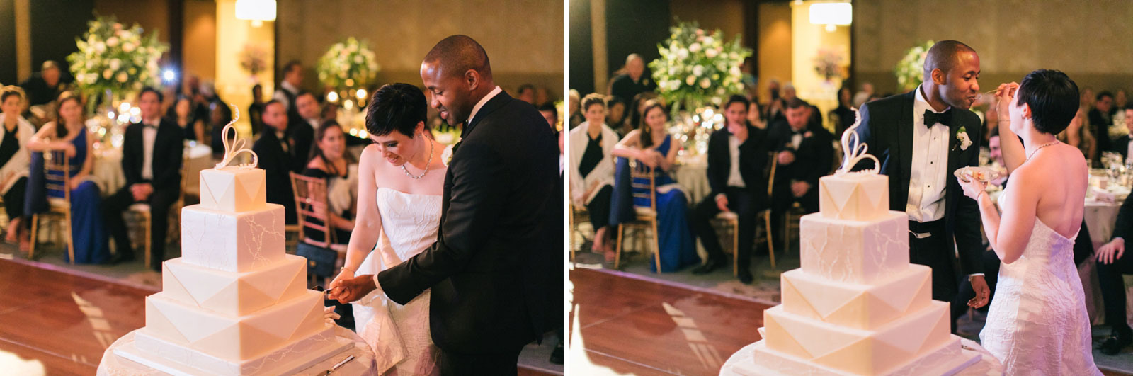 Bride and groom cut cake in modern ballroom at Ritz-Carlton during romantic winter wedding in Boston