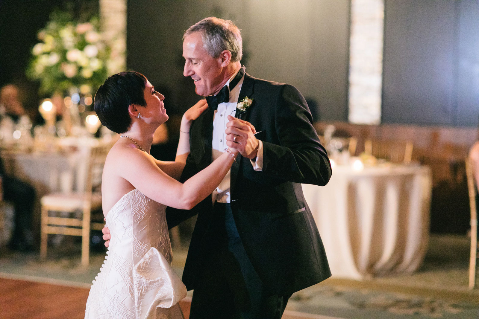 Father of the bride smiles proudly at bride during Father-daughter dance at Ritz-Carlton Boston