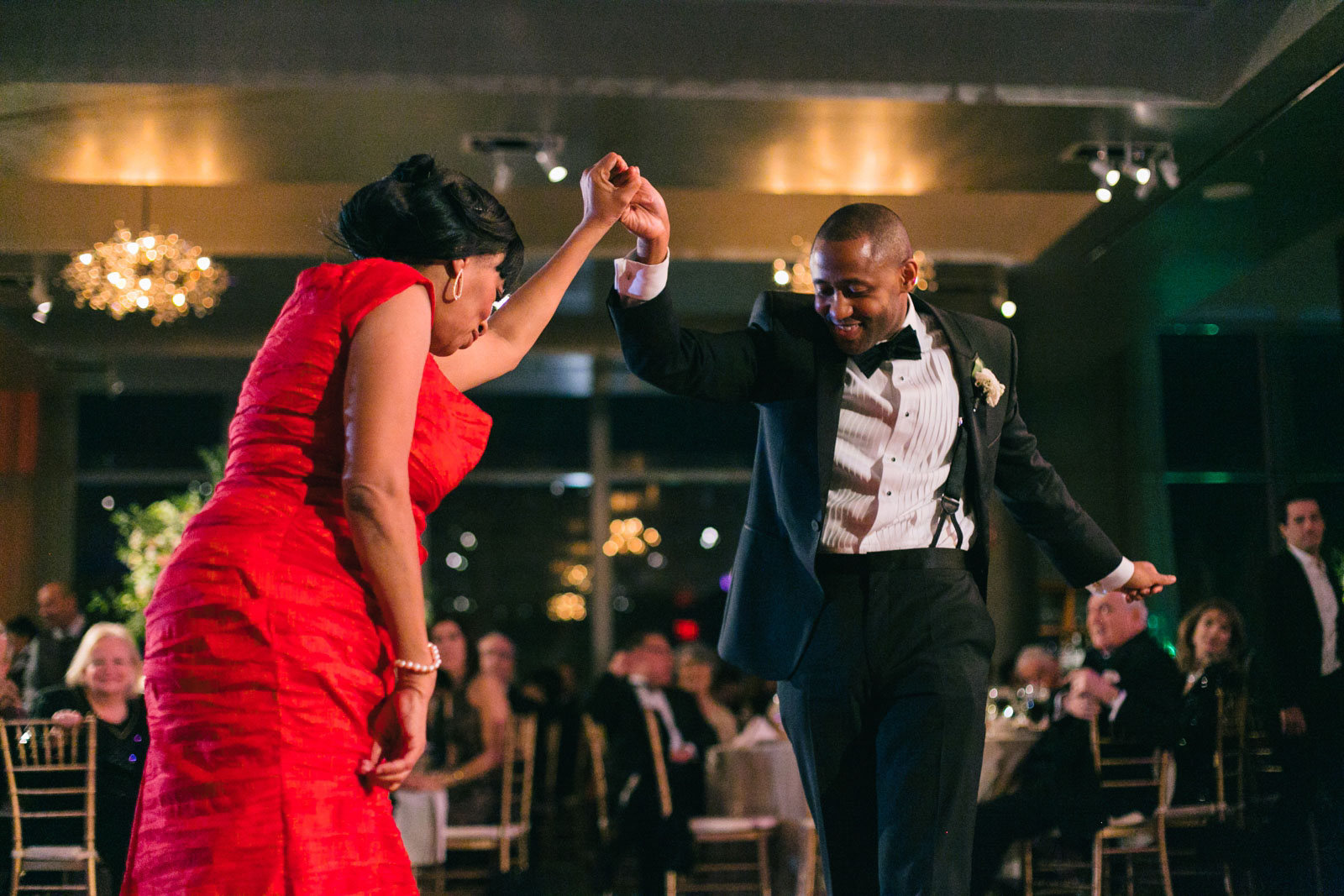 Groom and his mother bust a move on dance floor during their fun mother-son dance at Ritz-Carlton
