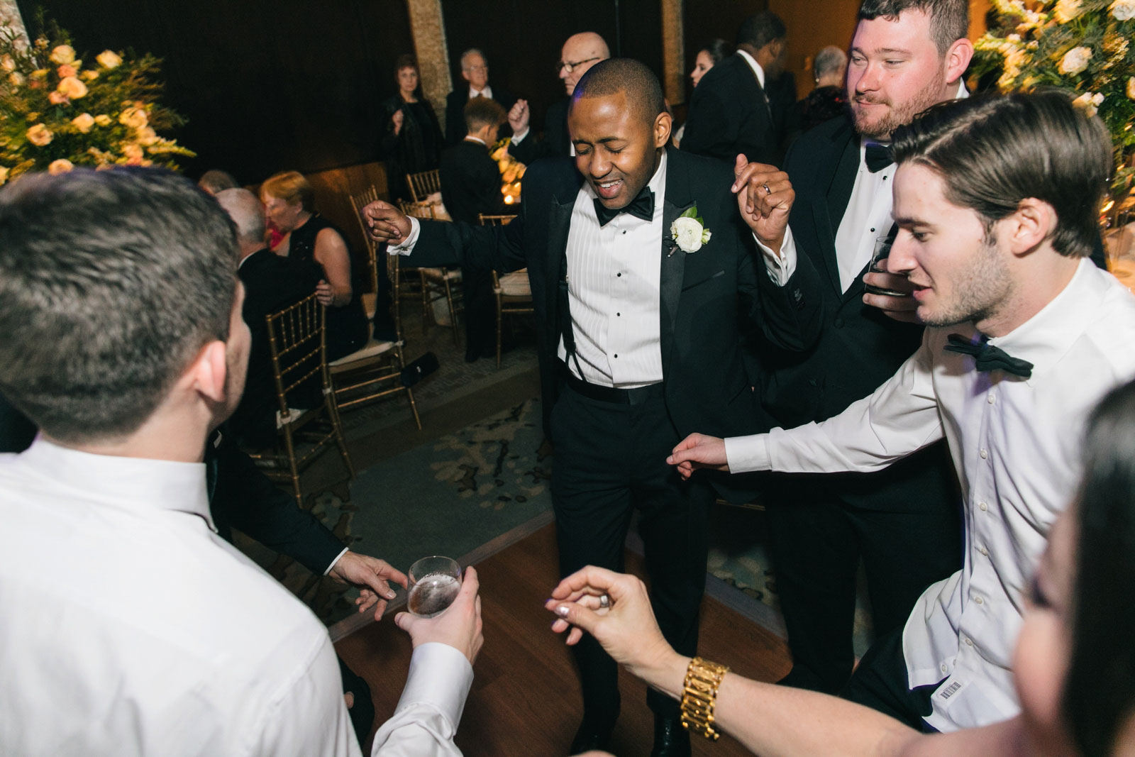 Groom getting jiggy with it on the dance floor at interracial wedding reception in Boston